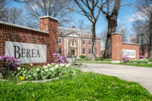 Berea College sign on campus in the spring