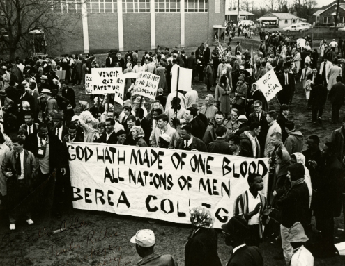 Historical photo of Berea students in Selma holding a sign with the College motto